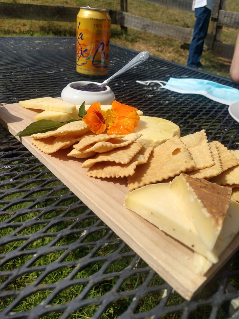 A cheeseboard in the back yard of Looking Glass Creamery.